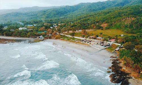 ideal surfing spots near Manila